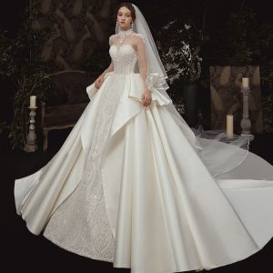 Vintage / Retro See-through Ivory Satin Wedding Dresses 2020 Ball Gown High Neck Long Sleeve Backless Appliques Lace Handmade  Beading Royal Train Ruffle