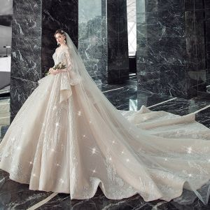 Illusion Champagne See-through Wedding Dresses 2020 Ball Gown Deep V-Neck 3/4 Sleeve Backless Glitter Tulle Appliques Lace Beading Cathedral Train Ruffle