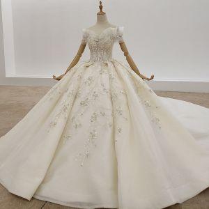 Mode Champagner Ballkleid Brautkleider / Hochzeitskleider 2020 Tülle Gekreuzte Träger Handgefertigt Rückenfreies Perlenstickerei Kristall Perle Pailletten Kathedrale Schleppe Hochzeit