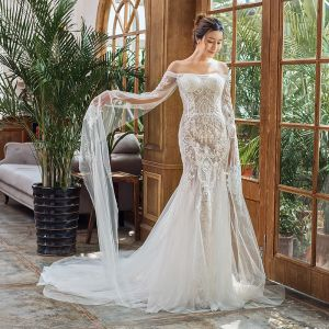 Elegant Ivory Beach Wedding Dresses 2020 Trumpet / Mermaid Off-The-Shoulder Long Sleeve Backless Appliques Lace Court Train Ruffle