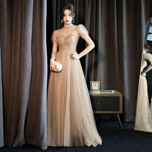 Vintage / Originale Doré Transparentes Dansant Robe De Bal 2021 Princesse Col Haut Manches Courtes Perlage Faux Diamant Longue Volants Dos Nu Robe De Ceremonie