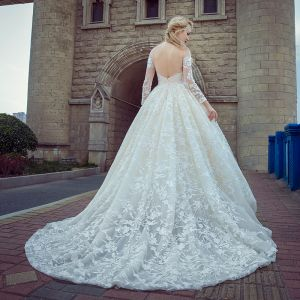 Stunning Champagne Pierced Wedding Dresses 2017 Ball Gown Scoop Neck Long Sleeve Backless Appliques Lace Chapel Train
