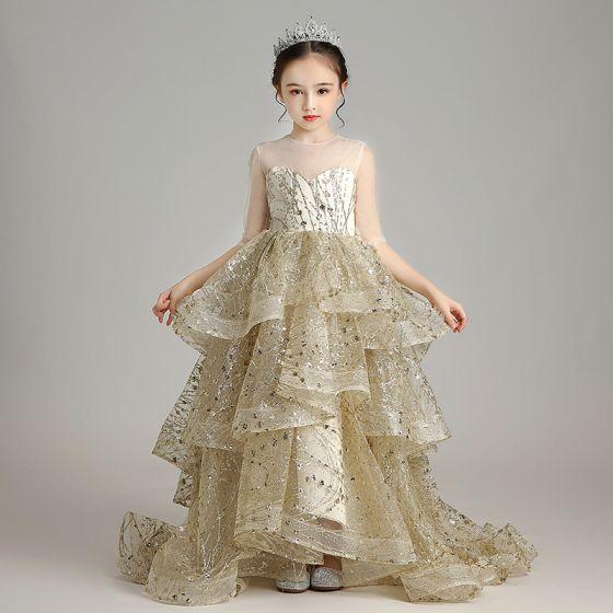 Brillante Oro Cumpleaños Vestidos para niñas 2020 Ball Gown Transparentes Scoop Escote 1/2 Ærmer Apliques Lentejuelas Colas De Barrido Volantes En Cascada