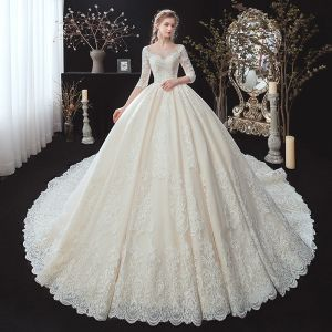 Classic Champagne See-through Bridal Wedding Dresses 2020 Ball Gown Scoop Neck 3/4 Sleeve Backless Appliques Lace Beading Cathedral Train Ruffle