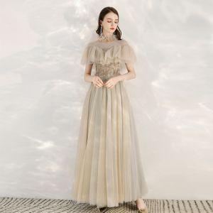 Eleganta Champagne Grå Genomskinliga Aftonklänningar 2020 Prinsessa Hög Hals Korta ärm Beading Långa Ruffle Formella Klänningar
