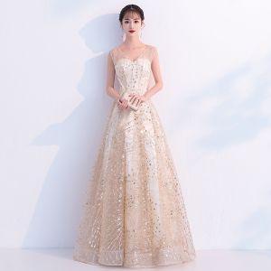 Bling Bling Champagne Transparentes Robe De Bal 2019 Princesse V-Cou Sans Manches Glitter Tulle Métal Ceinture Longue Volants Dos Nu Robe De Ceremonie