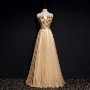 Chic / Beautiful Gold Dancing Prom Dresses 2020 A-Line / Princess Sweetheart Sleeveless Beading Glitter Tulle Floor-Length / Long Ruffle Backless Formal Dresses