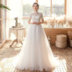 Affordable Outdoor / Garden White Wedding Dresses 2020 A-Line / Princess See-through High Neck Short Sleeve Backless Appliques Sequins Sweep Train Ruffle