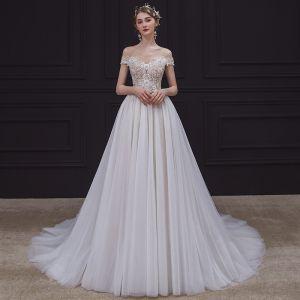 Illusion Champagne Brud Bröllopsklänningar 2020 Prinsessa Genomskinliga Urringning Ärmlös Halterneck Appliqués Spets Beading Domstol Tåg Ruffle