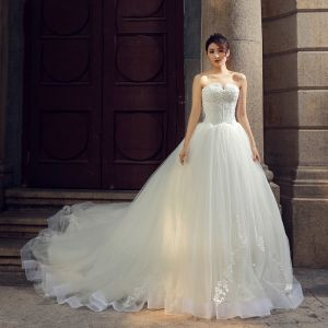 Elegant Ivory Wedding Dresses 2019 Ball Gown Strapless Sleeveless Backless Appliques Lace Sequins Chapel Train Ruffle