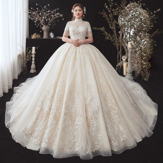 Vintage / Retro Champagne Plus Size Wedding Dresses 2020 See-through High Neck Short Sleeve Backless Beading Tassel Appliques Lace Sequins Cathedral Train Ruffle