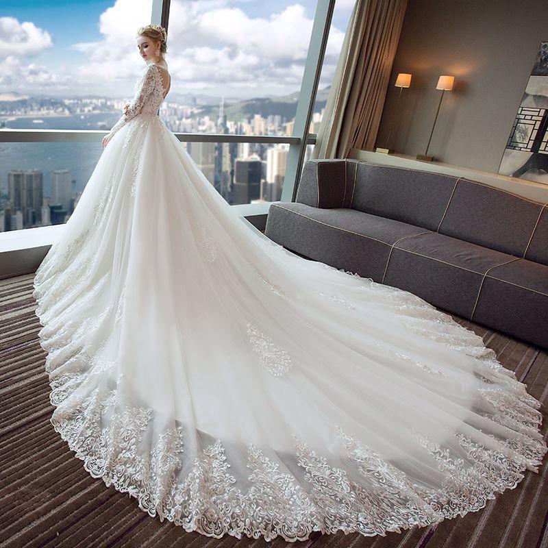 Elegante Ivory / Creme Brautkleider / Hochzeitskleider 2017 A Linie V-Ausschnitt Lange Ärmel Rückenfreies Applikationen Spitze Perlenstickerei Perle