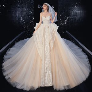 Best Champagne Bridal Wedding Dresses 2020 Ball Gown Sweetheart Sleeveless Backless Appliques Lace Beading Royal Train