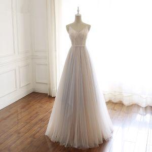 Stylowe / Modne Szampan Sukienki Na Bal 2019 Princessa Spaghetti Pasy V-Szyja Frezowanie Cekiny Bez Rękawów Bez Pleców Kokarda Długie Sukienki Wizytowe