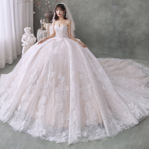 Best Champagne Wedding Dresses 2020 Ball Gown Sweetheart Sleeveless Backless Flower Appliques Lace Cathedral Train Ruffle