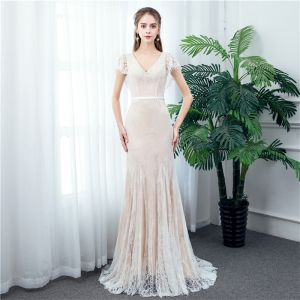 Chic / Beautiful Outdoor / Garden Champagne Lace Wedding Dresses 2020 Trumpet / Mermaid V-Neck Short Sleeve Backless Pearl Sash Sweep Train Ruffle
