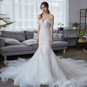 Elegant Ivory Wedding Dresses 2019 Trumpet / Mermaid Off-The-Shoulder Short Sleeve Backless Appliques Lace Chapel Train Ruffle