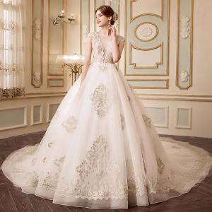 Elegant Champagne Wedding Dresses 2018 Ball Gown See-through V-Neck Sleeveless Backless Appliques Lace Beading Cathedral Train Ruffle