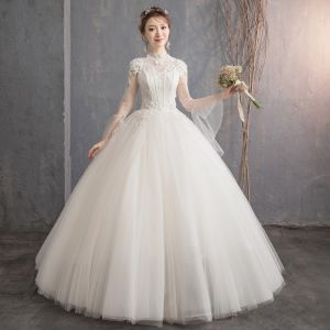 Affordable Champagne See-through Outdoor / Garden Wedding Dresses 2019 Ball Gown High Neck Bell sleeves Backless Appliques Lace Pearl Beading Floor-Length / Long Ruffle