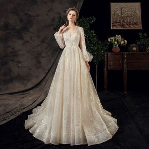 Affordable Outdoor / Garden Champagne See-through Wedding Dresses 2020 A-Line / Princess V-Neck Puffy Long Sleeve Backless Glitter Sequins Tulle Beading Sweep Train Ruffle