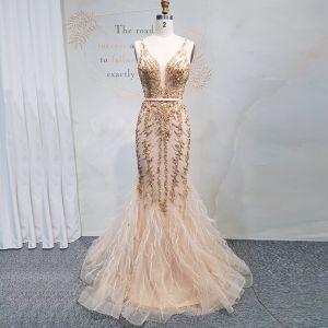 High End Gold Abendkleider 2020 Meerjungfrau Tiefer V-Ausschnitt Ärmellos Stoffgürtel Perlenstickerei Pailletten Lange Rüschen Rückenfreies Festliche Kleider