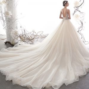 Illusion Champagne Pierced Wedding Dresses 2019 A-Line / Princess Spaghetti Straps Backless Sleeveless Handmade  Beading Glitter Tulle Cathedral Train