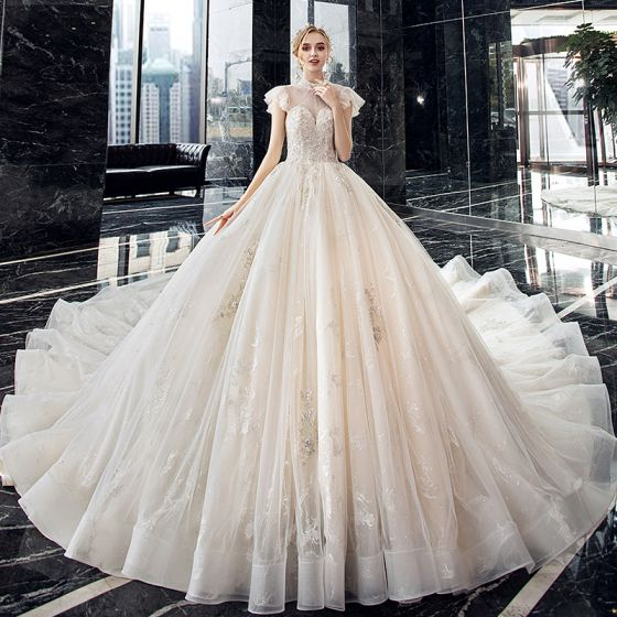 Vintage / Retro Champagne See-through Bridal Wedding Dresses 2020 Ball Gown High Neck Sleeveless Backless Beading Appliques Lace Sequins Cathedral Train Ruffle