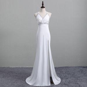 Piękne Białe Sukienki Wieczorowe 2019 Syrena / Rozkloszowane Spaghetti Pasy Rhinestone Bez Rękawów Bez Pleców Podział Przodu Trenem Sweep Sukienki Wizytowe