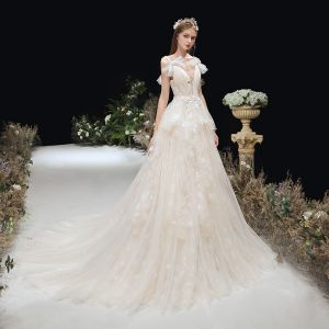 Chic / Beautiful Champagne Bridal Wedding Dresses 2020 A-Line / Princess See-through Deep V-Neck Bow Shoulders Sleeveless Backless Appliques Lace Court Train Ruffle