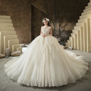Stunning Champagne Bridal Wedding Dresses 2020 Ball Gown Sweetheart Sleeveless Backless Sequins Beading Glitter Tulle Cathedral Train Ruffle