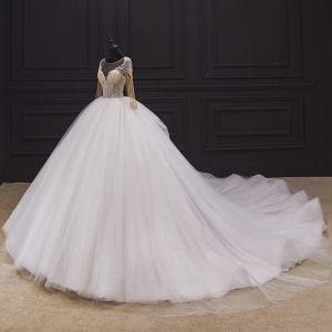 Iluzja Kość Słoniowa ślubna Suknie Ślubne 2020 Suknia Balowa Przezroczyste Wycięciem Długie Rękawy Bez Pleców Wykonany Ręcznie Frezowanie Trenem Katedra Wzburzyć