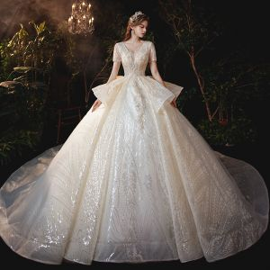 Sparkly Champagne Bridal Wedding Dresses 2020 Ball Gown V-Neck Short Sleeve Backless Appliques Sequins Cathedral Train Ruffle