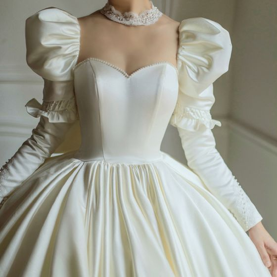 Vintage / Retro Ivory Satin Bridal Wedding Dresses 2021 Ball Gown See-through High Neck Puffy Long Sleeve Backless Beading Pearl Cathedral Train Ruffle