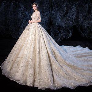 Luxe Champagne Robe De Mariée 2020 Princesse Encolure Dégagée Fait main Perlage Perle Paillettes En Dentelle Fleur Manches Courtes Dos Nu Royal Train
