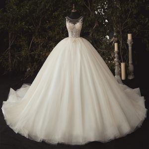 Illusion Ivory Bridal Wedding Dresses 2020 Ball Gown See-through Scoop Neck Sleeveless Backless Appliques Sequins Beading Cathedral Train Ruffle