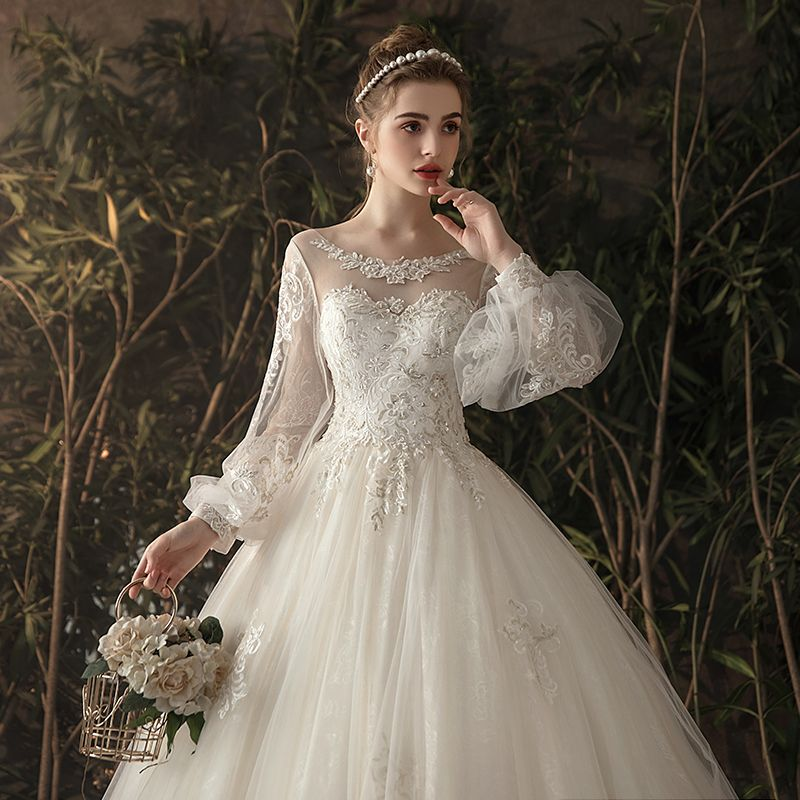 Elegant Ivory See-through Wedding Dresses 2019 Princess Scoop Neck Puffy Long Sleeve Backless Appliques Lace Chapel Train Ruffle