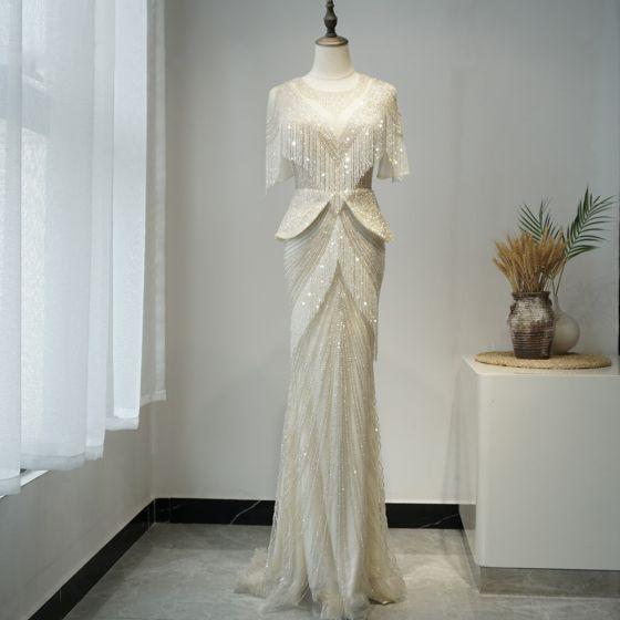 Luxus / Herrlich Champagner Roter Teppich Abendkleider 2020 Meerjungfrau Durchsichtige Rundhalsausschnitt Kurze Ärmel Handgefertigt Perlenstickerei Quaste Sweep / Pinsel Zug Festliche Kleider