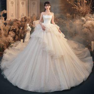 Romantisk Elfenben Brud Bröllopsklänningar 2020 Balklänning Axelbandslös Ärmlös Halterneck Glittriga / Glitter Tyll Cathedral Train Ruffle