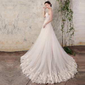 Chic / Beautiful Champagne Wedding Dresses 2018 A-Line / Princess Appliques Pearl Organza Spaghetti Straps Backless Sleeveless Court Train Wedding