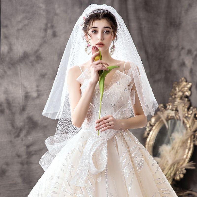 Luxus / Herrlich Champagner Brautkleider / Hochzeitskleider 2019 Ballkleid Spaghettiträger Pailletten Ärmellos Rückenfreies Schleife Königliche Schleppe