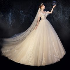 Illusion Champagne Wedding Dresses 2019 Ball Gown Spaghetti Straps Detachable Short Sleeve Backless Appliques Lace Beading Cathedral Train Ruffle