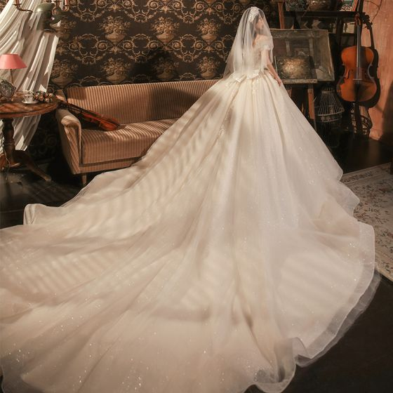 Roman Champagne Bridal Wedding Dresses 2020 Ball Gown Off-The-Shoulder Short Sleeve Backless Appliques Lace Beading Glitter Tulle Cathedral Train Ruffle