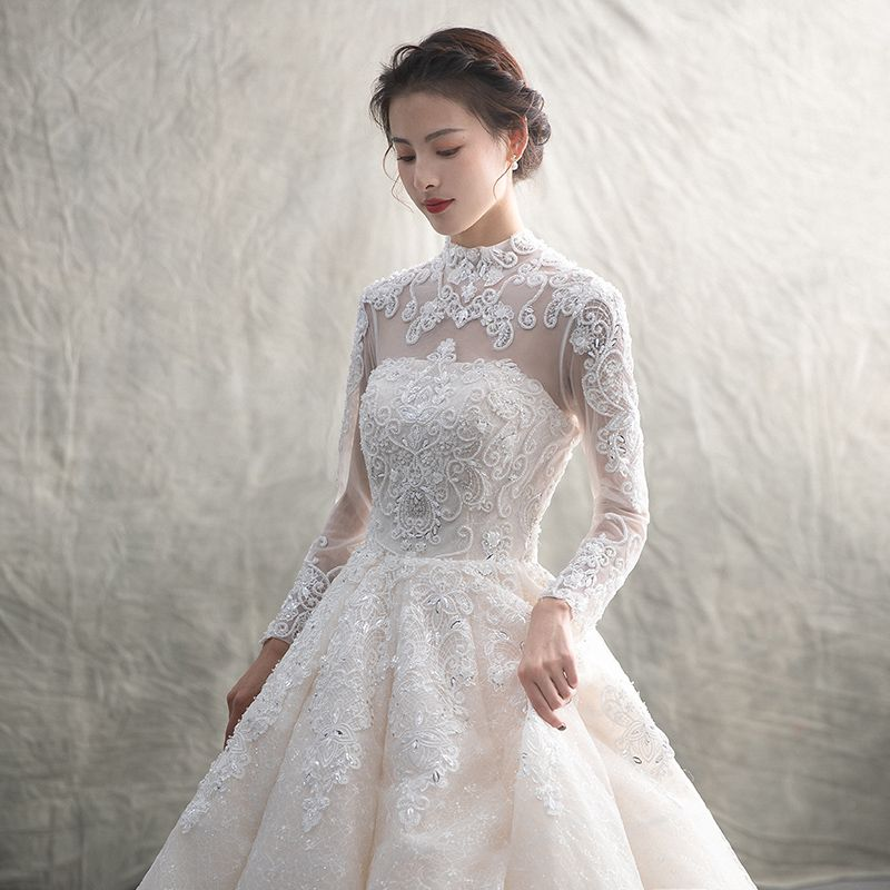 Luxury / Gorgeous Champagne See-through Wedding Dresses 2019 A-Line / Princess High Neck Long Sleeve Backless Appliques Lace Beading Glitter Tulle Cathedral Train Ruffle