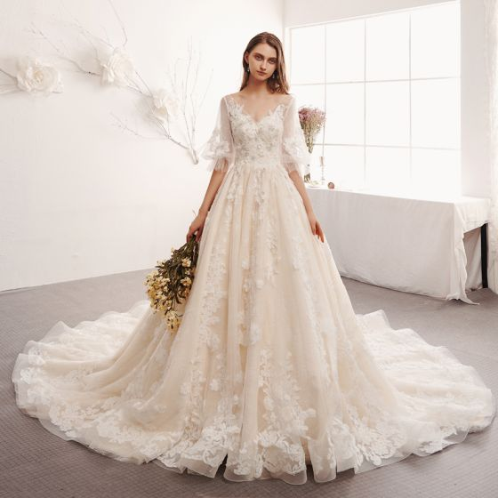 9bc475ac88e4 elegant-ivory-wedding-dresses-2019-a-line-princess-v-neck-puffy-1-2-sleeves- backless-appliques-lace-beading-pearl-cathedral-train-ruffle-560x560.jpg