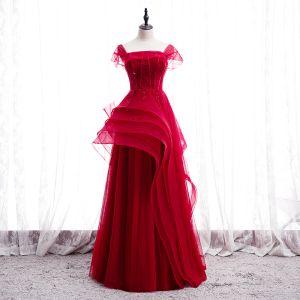 Snygga / Fina Röd Dansande Balklänningar 2020 Prinsessa Fyrkantig Ringning Ärmlös Appliqués Spets Beading Långa Ruffle Halterneck Formella Klänningar