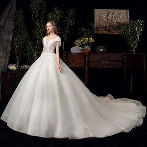 Chic / Beautiful Ivory See-through Bridal Wedding Dresses 2020 Ball Gown Scoop Neck Short Sleeve Backless Beading Tassel Glitter Tulle Chapel Train