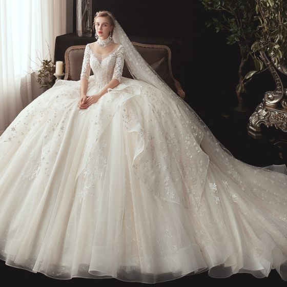 Romantic Ivory See-through Wedding Dresses 2020 Ball Gown Scoop Neck 1/2 Sleeves Backless Glitter Tulle Star Appliques Lace Chapel Train Ruffle