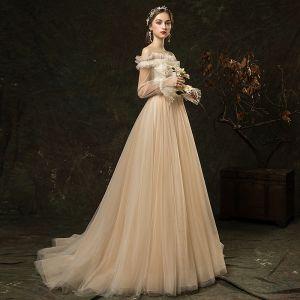 Eleganta Champagne Trädgård / Utomhus Bröllopsklänningar 2019 Prinsessa Ruffle Av Axeln Beading Pärla Appliqués Spets Blomma Paljetter Långärmad Halterneck Svep Tåg