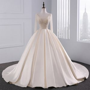 Luxury / Gorgeous Champagne Wedding Dresses 2017 Ball Gown Pierced V-Neck Long Sleeve Backless Beading Pearl Rhinestone Chapel Train Ruffle