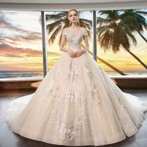 Elegant Champagne See-through Wedding Dresses 2019 A-Line / Princess Scoop Neck Cap Sleeves Appliques Lace Beading Glitter Tulle Cathedral Train Ruffle